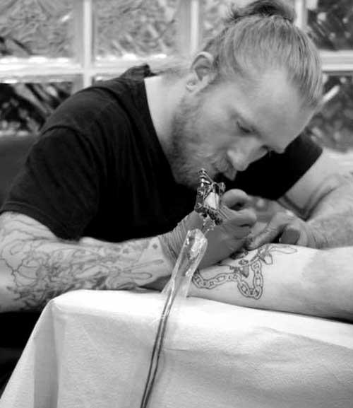 Kelly working on a new tattoo