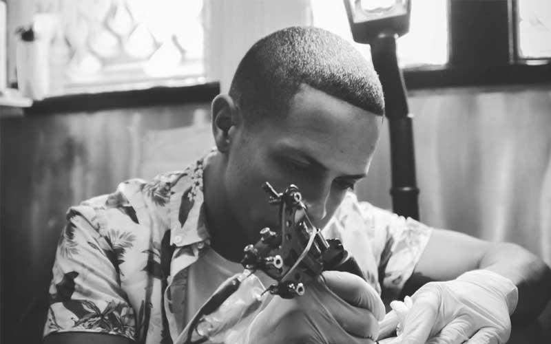 carlos working on a new tattoo